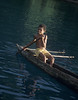 Village boy in dugout canoe - Milne Bay, Papua New Guinea