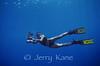 Photographer Cynthia Hankins in blue water several miles off Kona, Big Island, Hawaii