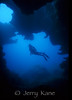"""Lori Kane hovering at a cave entrance at Pupukea, Oahu, Hawaii  To see more Hawaii reef scenes, click <A HREF=""""http://sealifeimages.smugmug.com/gallery/6175622_gJxjd#425066633_qHr7a""""> here</a>"""