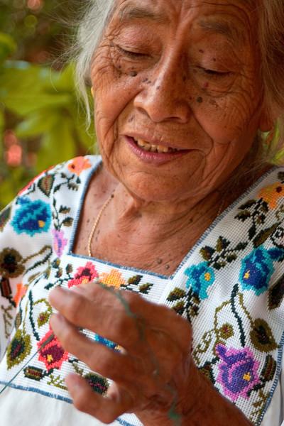 A Mayan woman embroidering a huipil, a traditional woman's blouse.<br /> Santa Elena, Yucatan, Mexico