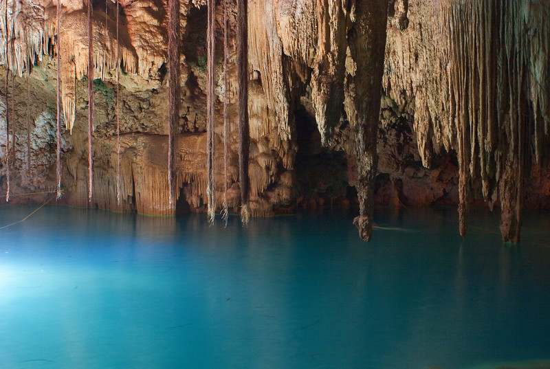 Cenote Dzitnup, Yucatan, Mexico<br /> <br /> A cenote is a freshwater-filled sinkhole or cavern that was sacred to the ancient Maya and the source of thier freshwater. Today it is a tourist destination for swimming, scuba diving, and exploring.