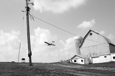 Farmstead - scenic - crop-dusting plane over barn