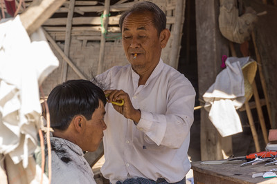 barber at market, Inle Lake, Myanmar