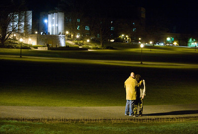 "I took this image just two nights after the tragedy at Virginia Tech. We were standing beside the makeshift memorial to the fallen. The utter desolation of the man in cammoflaged trousers is so apparent, as is the tenderness of his friend. Imagine this scene with two pipers playing ""Amazing Grace"" somewhere out in the darkness. Those somber, yet resilient notes were indeed ringing out across the drillfield as the shutter clicked just one time. This moment will always haunt me."