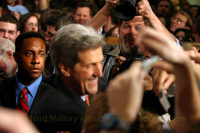 An aide to Senator John Kerry looks on as Kerry works the crowd at George Mason University on the night of Kerry's victory celebrations for the 2004 Virginia Democratic Presidential Primary. I love this image, because the focus is off Kerry, and on his aide. The very concerned and sympathetic look on the aide's face is so evocative, and stirs my heart each time I look at it.