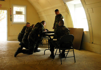 These Marines of Delta Company, 4th LAR, were signing their wills and power of attourney forms in one of the old Quonset Huts at Camp Upshur, Marine Corps Base Quantico in february 2003. They were due to depart for the war in Iraq a few days later. I had come to know several of them pretty well over the previous two years, and this moment was a particularly hard one to record. In retrospect, looking at the photograph, it has the appearance of renaissance painting of a religious ceremony, the marine standing behind the altar like a priest, while the others neal before him. It was a powerful moment, and still moves me every time I see it.