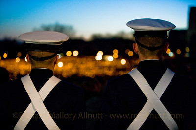 Two ROTC cadets stare out at a sea of light during the candle light vigil at Virginia Tech following the tragedy on campus in April, 2007.