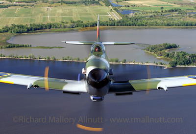 Mike Potter in his WWII Supermarine Spitfire hangs tightly onto our tail as we fly over the Ottawa River. This image was from a series of mine published in several international aviation magazines including Flypast, Flight Journal and Combat Aircraft. This image won a regional avaition photography contest in 2004.