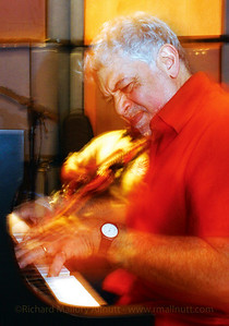Monty Alexander jamming on his piano with Ernie Ranglin on guitar during his interview with Dermot Hussey at XM Radio's headquarters in Washington, DC. This image formed the entire table of contents page in the August 2004 issue of JazzTimes Magazine.