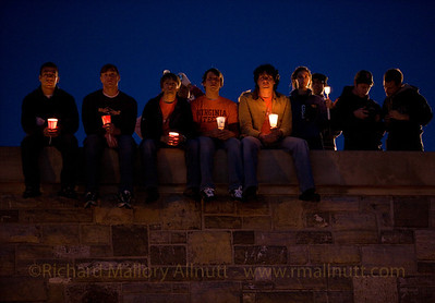 Students at Virginia Tech sit atop the War Memorial Chapel during the candle light vigil following the massacre at Virginia Tech in April, 2007.
