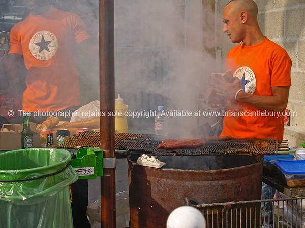 Barbeque, street food vendors, cooking sausages over a barrel in the Montmatre district Paris. Model Release; No. Editorial or personal use only.