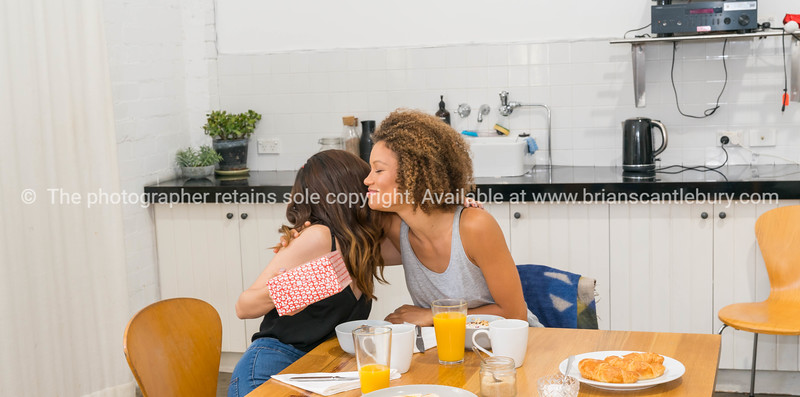 Young women at breakfast table