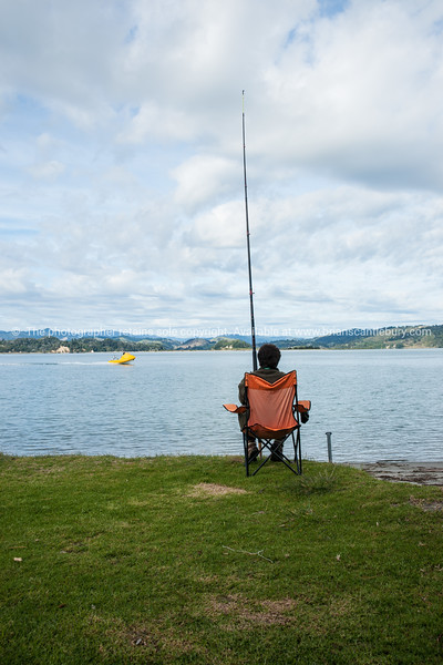 """Lady sitting in chair on edge of Ohiwa Harbour, fishing.<br /> More interesting people shots at;  <a href=""""http://smu.gs/QBLqN"""">http://smu.gs/QBLqN</a> or try keyworing people in the search tool above"""