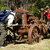 Old tractor attract the attention of trampers. New Zealand photographic stock images.<br /> Model released; no, for editorial & personal use.