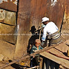 """Mother and child collecting water from a standpipe in Soweto, South Africa. <br />  <a href=""""http://smu.gs/YlqpWr"""">http://smu.gs/YlqpWr</a> FOR MORE AFRICAN IMAGES.<br /> Model Release; No. Editorial or personal use only."""
