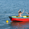 Children in colourful dinghy.