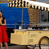Business is slow today. Ice cream vendor stands by her cart and speaks on the phone. Model Release; No. Editorial or personal use only.