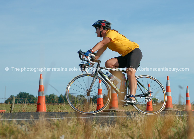 """Contestant at Bell Road cycling turn-around, POT Half Ironman-10. Tauranga, Bay of Plenty, New Zealand. Tauranga is New Zealands 5th largest city and offers a wonderfull variety of scenic and cultural experiences. ALSO SEE; <a href=""""http://www.blurb.com/b/3811392-tauranga"""">http://www.blurb.com/b/3811392-tauranga</a><br /> Check our """"EVENTS"""" galleries for heaps more; <a href=""""http://www.brianscantlebury.com/Events"""">http://www.brianscantlebury.com/Events</a>"""