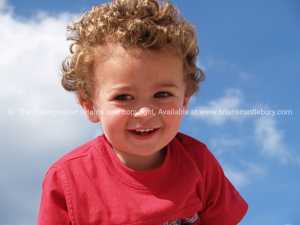 Happy child against sky