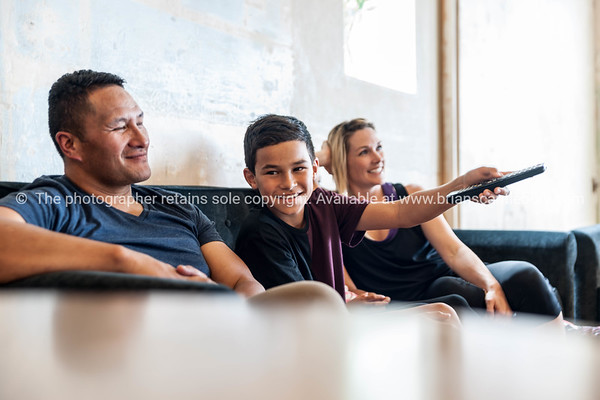 Family sitting together in lounge