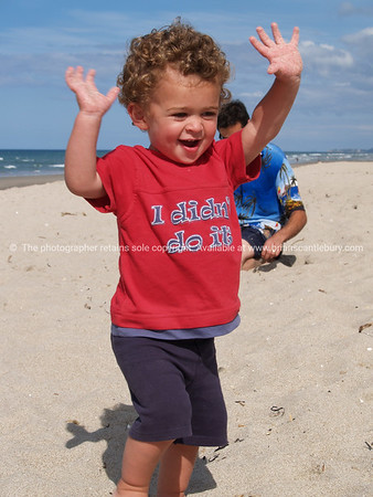 Playing, gleeful at Papamoa Beach<br /> <br /> Model/property release; Yes.
