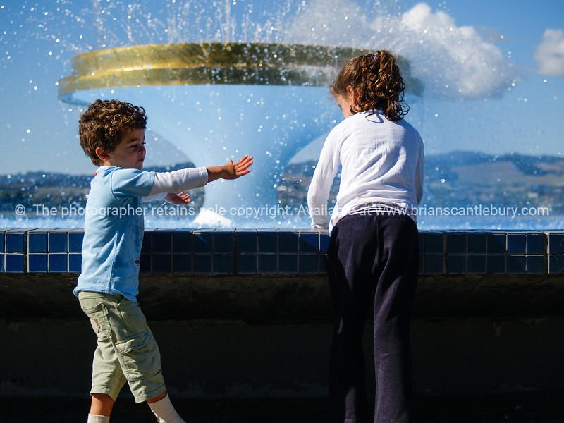 Two children at Memorial Park Fountain, Tauranga