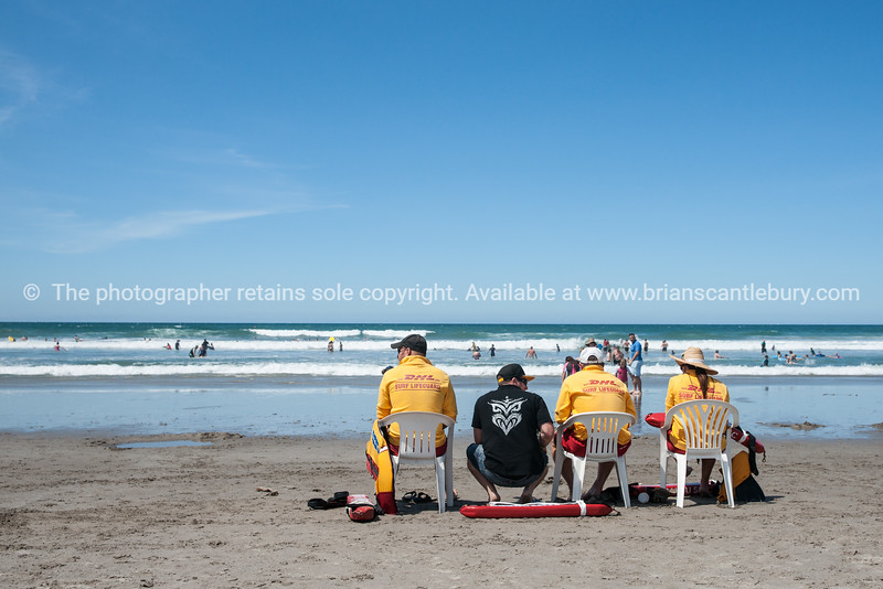 Lifeguards keep an eye on swimmers knowing of a serious rip that could cause problems, Mount Maunganui. See; www.blurb.com/b/3811392-tauranga or try keyworing people in the search tool above