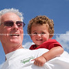 grandfather and grandson playing at beach together in summer
