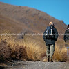 """Trampers head off on the Tongariro Crossing, in New Zealand's Tongariro national Park. New Zealand photographic stock images.<br /> Model Release; no.<br /> More interesting people shots at;  <a href=""""http://smu.gs/QBLqN"""">http://smu.gs/QBLqN</a> or try keyworing people in the search tool above<br /> Check our """"EVENTS"""" galleries for heaps more; <a href=""""http://www.brianscantlebury.com/Events"""">http://www.brianscantlebury.com/Events</a>"""
