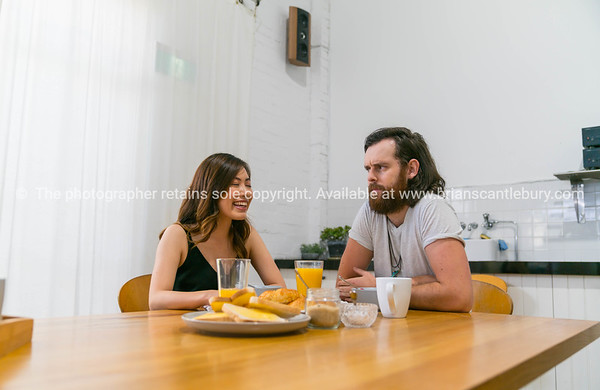 Young couple having breakfast together at table