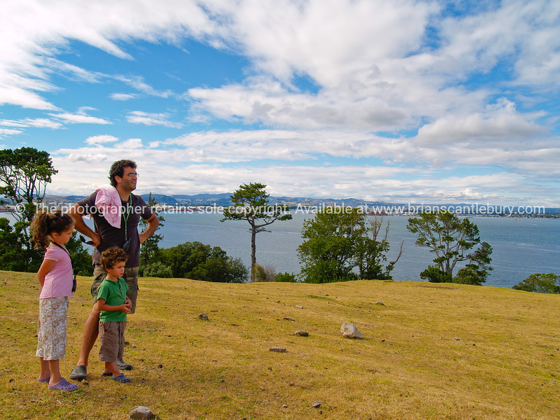 Father with two children looking at Tuaranga Harbour view from slopes of Mount maunganui.<br /> Model release; Yes.