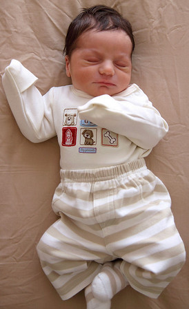 Baby trying out his new outfit at two days old, Englewood, NJ