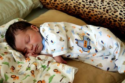 Baby sleeping on his cushions, Englewood, NJ
