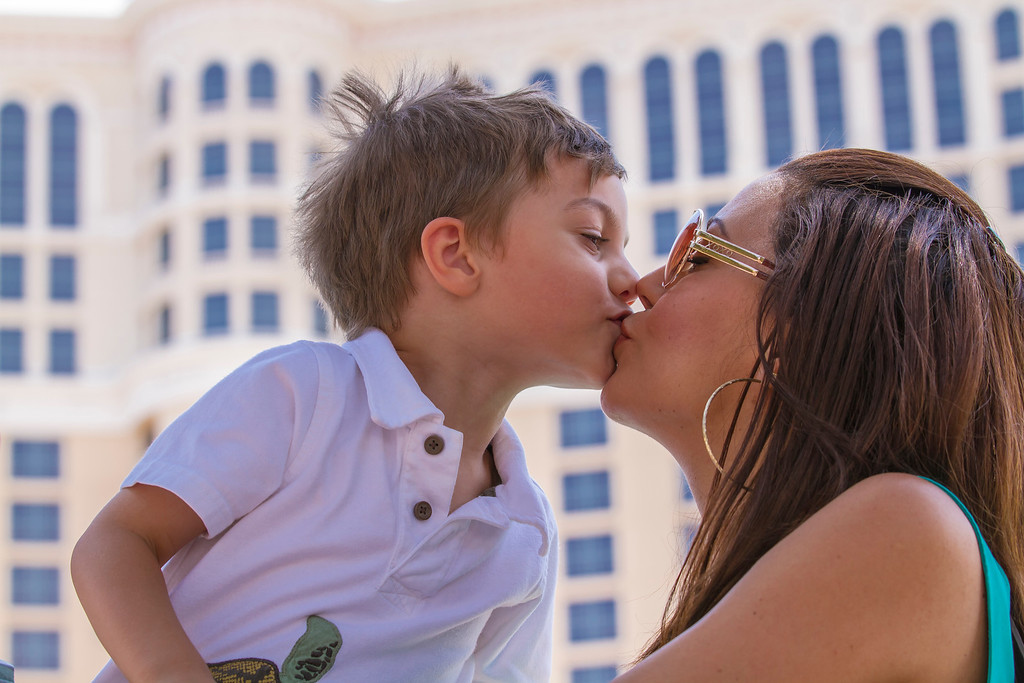Momma and son giving kisses in front of Bellagio.  Las Vegas, NV