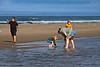 A family at play on the beach.<br /> <br /> Haystack Rock Beach<br /> Bandon, Oregon<br /> September 2010