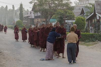 giving alms, Nyaugshwe, Lake Inle,  Myanmar