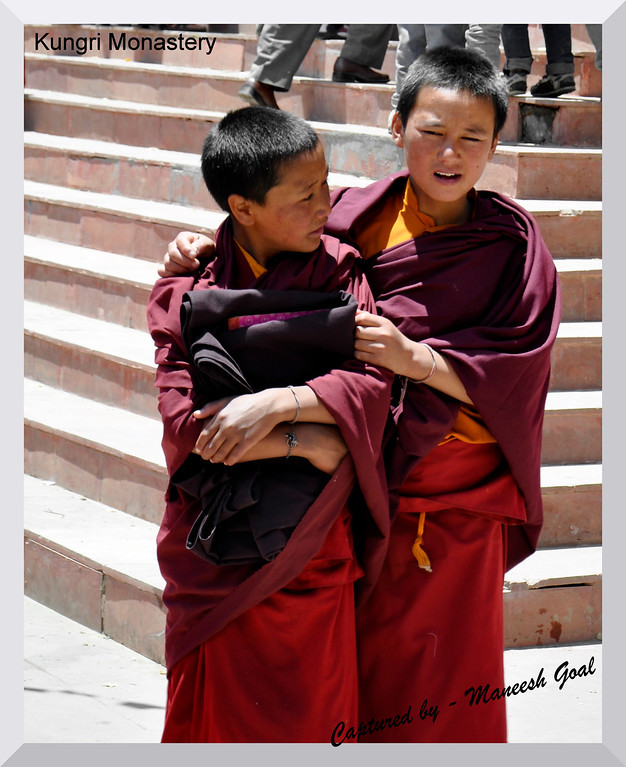 Young monks sharing a secret