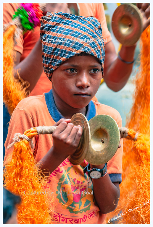 Young boy playing cymbals