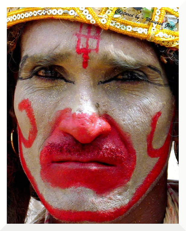A poor tribal man playing Lord Hanuman during local festival - the pain on his face is the story of his life!