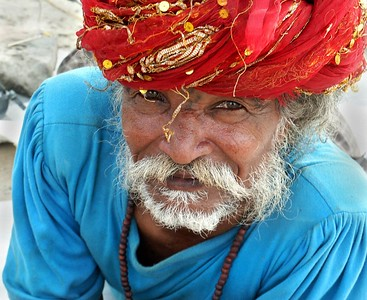 Man in a Gypsy Encampment outside of Ferozpur, Punjab. North India.