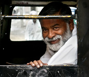 Man in a Motorized Richshaw in Ferozpur, Punjab. North India.