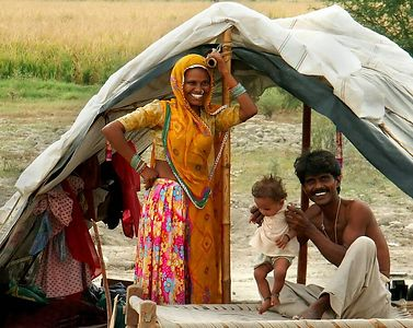 Young Family of a Gypsy Encampment outside of Ferozpur, Punjab. North India.