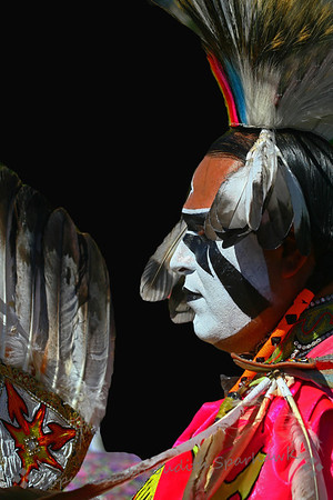 The Dancer With a White Face ~ This very handsome and striking man was about to join the dancing in the Grand Entry at the Pow Wow.  He proved to be an excellent dancer, carrying out an interesting and wild type of dance routine.
