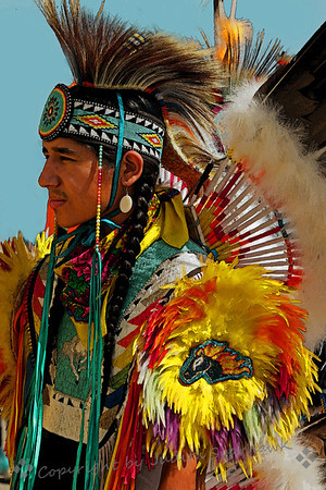 Dancer at the Pow Wow ~ This elaborately dressed dancer was about to go into the tent for the grand entry processional and dancing.  I loved his colors and the details on his head band and vest.