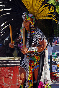 Aztec Dancer Drummer ~ The dances are accompanied with rhythmic drumbeats, by this large drum or smaller drums carried by the dancers.