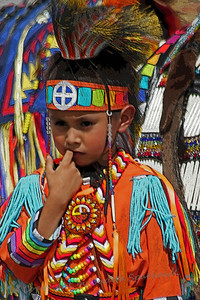 Little Dancer ~ This little boy was photographed at the Thunder & Lightning Pow Wow at Morongo this weekend.  I thought he was cute, standing waiting to go into the tent, with his finger in his mouth.