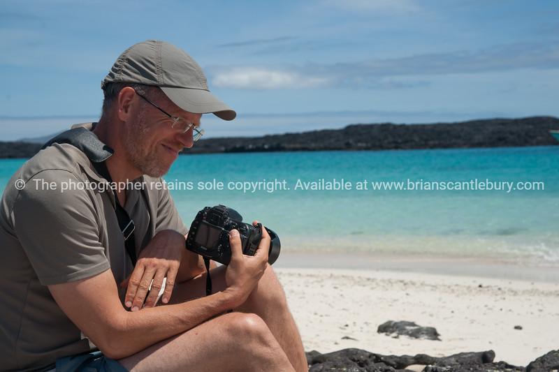 """Jorg, nursing his Sony.           <a href=""""http://www.blurb.com/b/3551540-galapagos-islands"""">http://www.blurb.com/b/3551540-galapagos-islands</a>"""