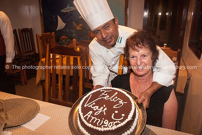 Feliz viagi amigos, the chef and our faarewell cake.          www.blurb.com/b/3551540-galapagos-islands
