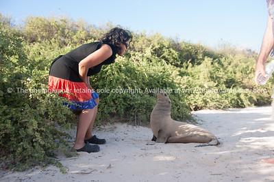 Fiorella and a sea lion.          www.blurb.com/b/3551540-galapagos-islands