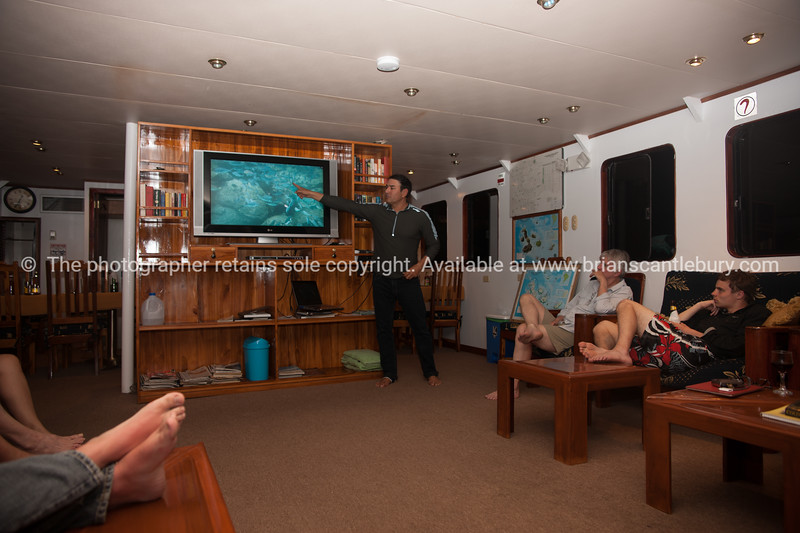 """Daniel giving an evening briefing, and review of the day.           <a href=""""http://www.blurb.com/b/3551540-galapagos-islands"""">http://www.blurb.com/b/3551540-galapagos-islands</a>"""
